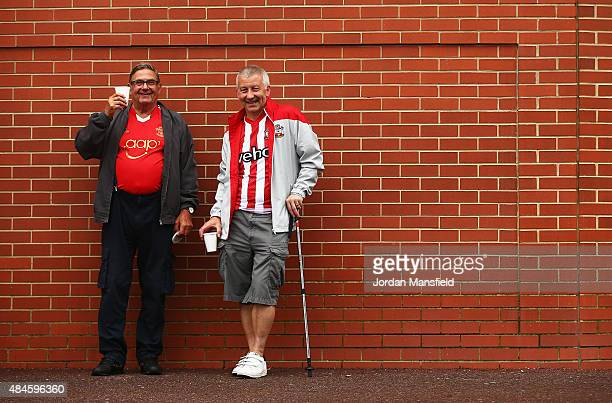 Southampton fans pose outside the ground prior to the UEFA Europa League Play Off Round 1st Leg match between Southampton and Midtjylland at St...