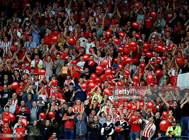 Southampton fans release balloons during the Barclays Premier League match between West Bromwich Albion and Southampton at The Hawthorns on August 17...