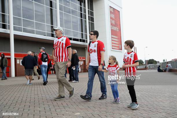 Southampton fans walk around the stadium prior to the Premier League match between Southampton and West Ham United at St Mary's Stadium on August 19...