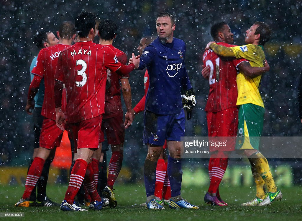 Southampton goalkeeper, <a gi-track='captionPersonalityLinkClicked' href=/galleries/search?phrase=Artur+Boruc&family=editorial&specificpeople=554761 ng-click='$event.stopPropagation()'>Artur Boruc</a> is congratulated by <a gi-track='captionPersonalityLinkClicked' href=/galleries/search?phrase=Maya+Yoshida&family=editorial&specificpeople=5398323 ng-click='$event.stopPropagation()'>Maya Yoshida</a> of Southampton after the Barclays Premier League match between Norwich City and Southampton at Carrow Road on March 9, 2013 in Norwich, England.