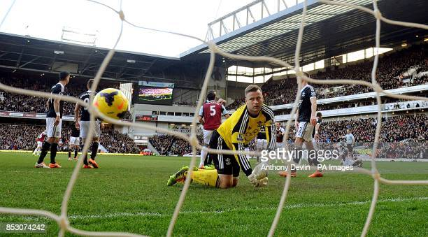 Southampton goalkeeper Artur Boruc looks dejected after West Ham United's Carlton Cole scores his side's second goal of the game