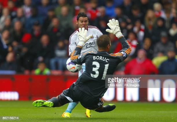 Southampton goalkeeper Artur Boruc saves a shot from West Ham United's Matthew Jarvis
