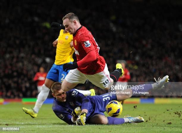 Southampton goalkeeper Artur Boruc saves from Manchester United's Wayne Rooney