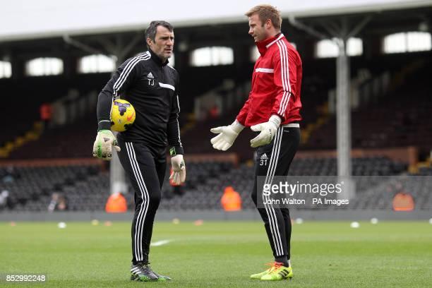 Southampton goalkeeper Artur Boruc speaks with goalkeeping coach Toni Jimenez during the warmup