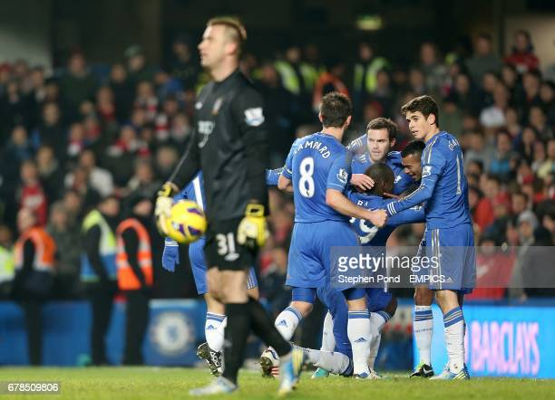 Southampton goalkeeper Artur Boruc stands dejected as Chelsea's Demba Ba celebrates with teammates after scoring their first goal of the game