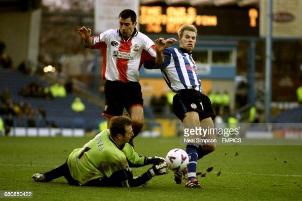 Southampton goalkeeper Paul Jones comes out to claim the ball as teammate Francis Benali and Sheffield Wednesday's Niclas Alexandersson chase it...