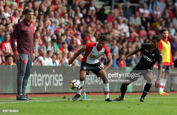 Southampton manager Mauricio Pellegrino watches on as Sofiane Boufal of Southampton tries to avoid Kyle Naughton of Swansea City during the Premier...