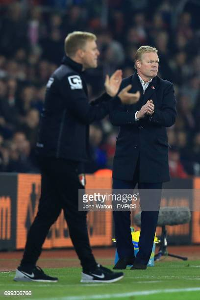 Southampton manager Ronald Koeman and AFC Bournemouth manager Eddie Howe encourage their teams on