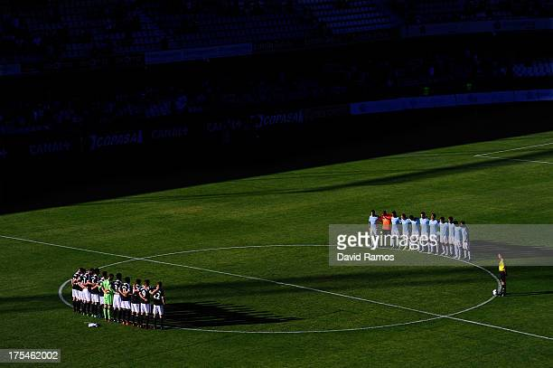 Southampton players and RC Celta de Vigo players observe a minute of silence in memory of the victims of the train crash of Santiago de Compostela...