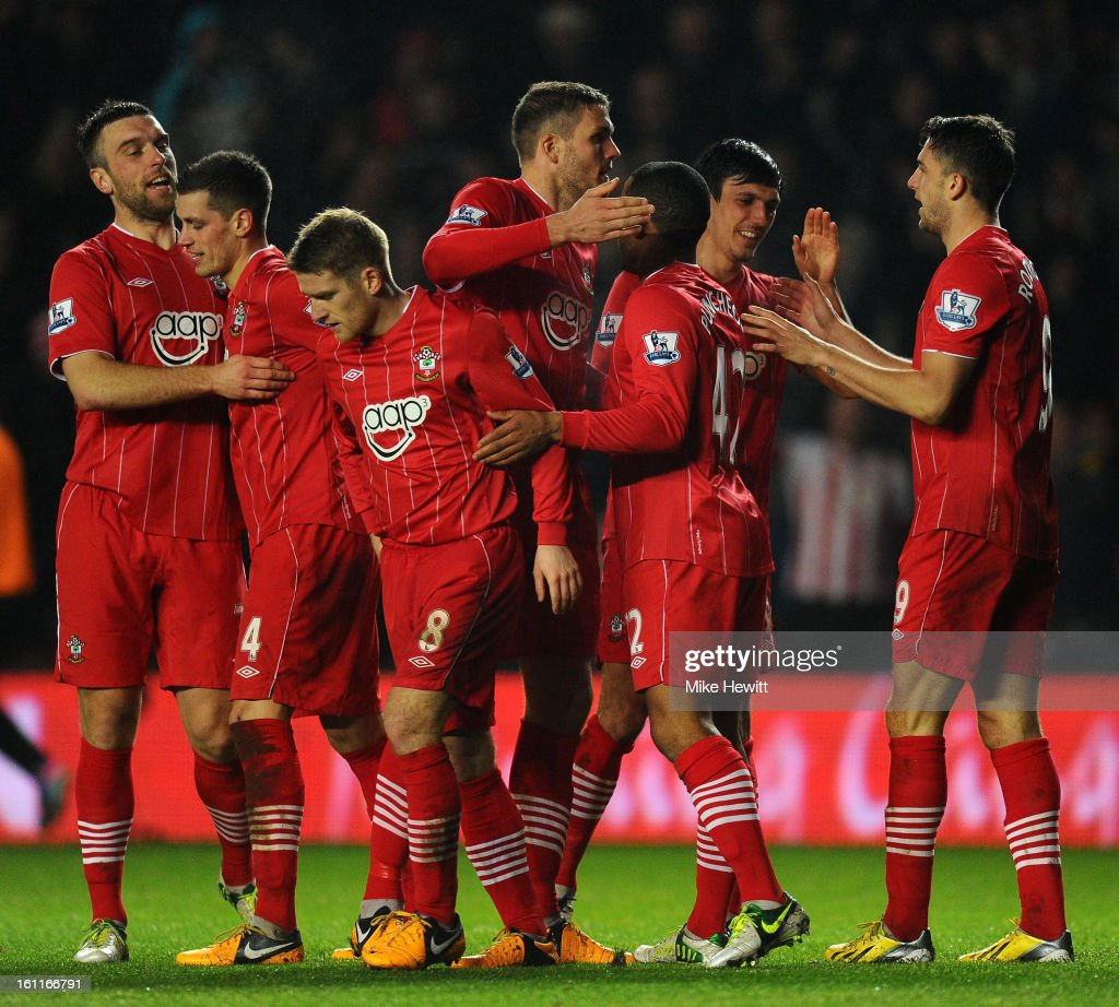 Southampton players celebrate after Gareth Barry of Manchester City (not pictured) scores an own goal making it 3-1 during the Barclays Premier League match between Southampton and Manchester City at St Mary's Stadium on February 9, 2013 in Southampton, England.