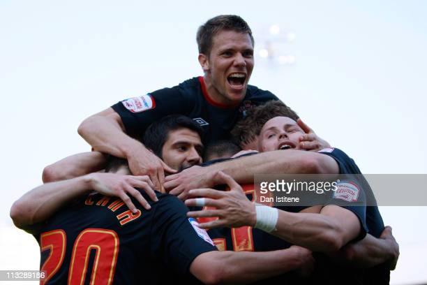Southampton players celebrate after scoring their third goal during the npower League One match between Brentford and Southampton at Griffin Park on...