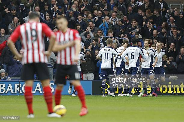 Southampton players wait to kick off as West Borm players celebrate Saido Berahino's early opening goal of the English Premier League football match...