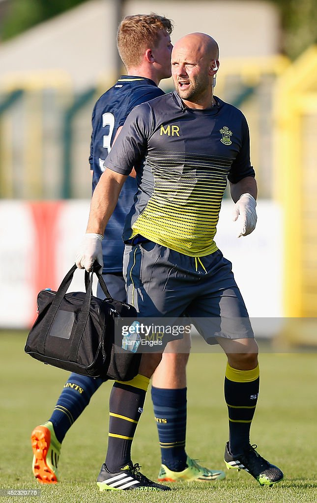 Southampton senior physiotherapist Matt Radcliffe is seen during the pre-season friendly match between KSK Hasselt and Southampton at the Stedelijk Sportstadion on July 17, 2014 in Hasselt, Belgium.