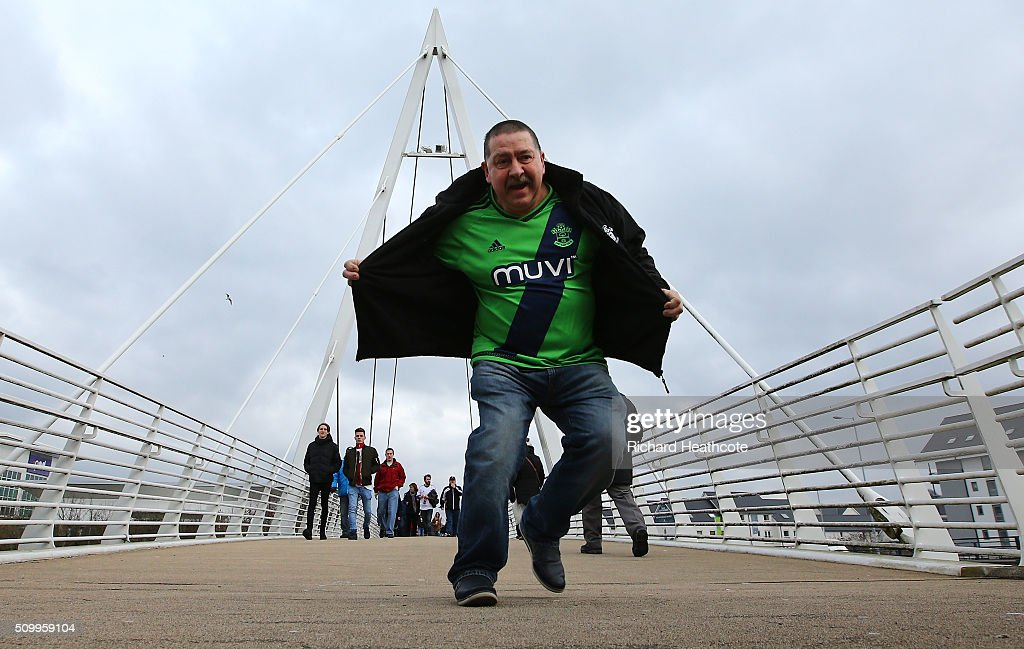 A Southampton supporter poses for photographs on the way to the stadium prior to the Barclays Premier League match between Swansea City and Southampton at Liberty Stadium on February 13, 2016 in Swansea, Wales.