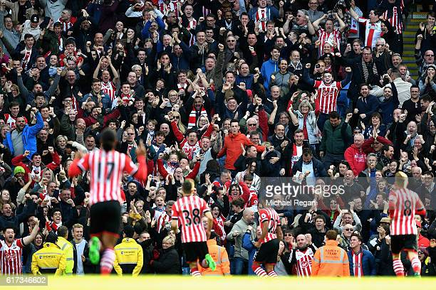 Southampton supporters celebrate after Nathan Redmond of Southampton scores their sides first goal during the Premier League match between Manchester...