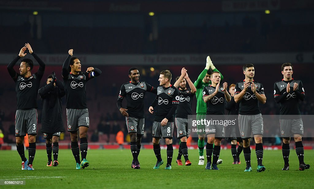 Southampton team celebrate following the EFL Cup quarter final match between Arsenal and Southampton at the Emirates Stadium on November 30, 2016 in London, England.