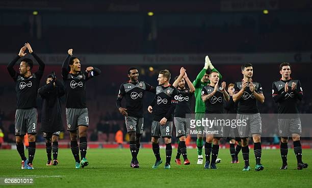 Southampton team celebrate following the EFL Cup quarter final match between Arsenal and Southampton at the Emirates Stadium on November 30 2016 in...