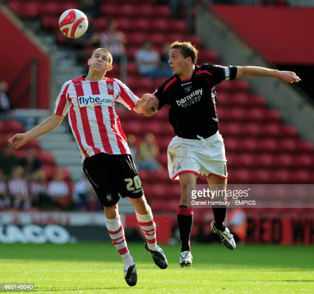 Southampton's Adam Lallana and Barnsley's Brian Howard battle