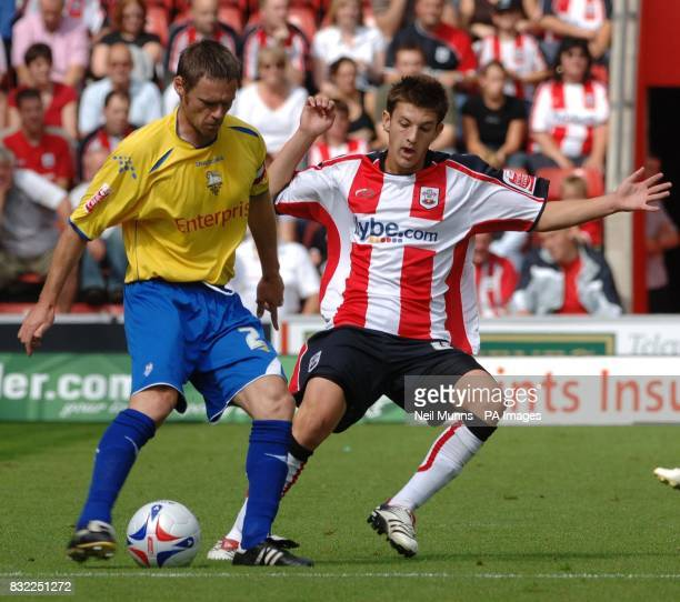 Southampton's Adam Lallana battles with Preston's Graham Alexander during the CocaCola Championship match at St Mary's Stadium Southampton