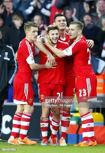Southampton's Adam Lallana celebrates scoring his teams opening goal with teammates
