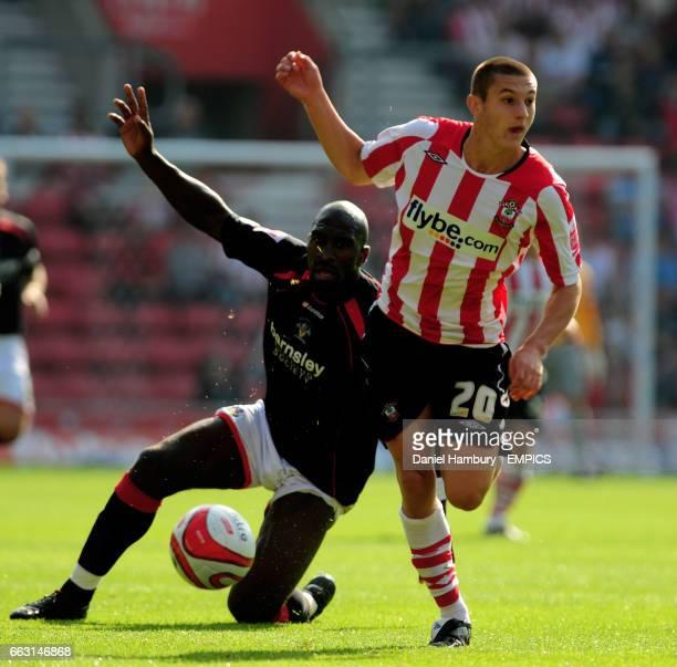 Southampton's Adam Lallana gets past Barnsley's Darren Moore