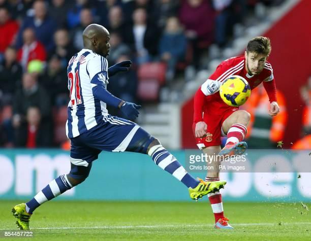 Southampton's Adam Lallana has a shot past West Bromwich Albion's Youssouf Mulumbu