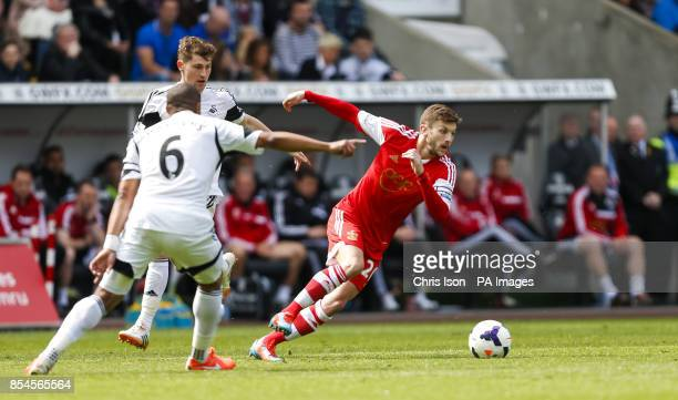 Southampton's Adam Lallana in action against Swansea City's Ashley Williams during the Barclays Premier League match at the Liberty Stadium Swansea