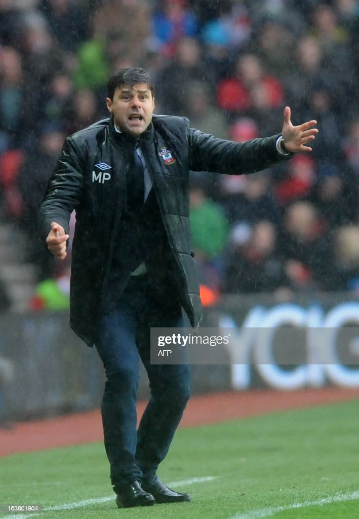 """Southampton's Argentinian manager Mauricio Pochettino gestures to players during the English Premier League football match between Southampton and Liverpool at St Mary's Stadium in Southampton on March 16, 2013. Southampton won 3-1. AFP PHOTO/ Olly GREENWOOD - RESTRICTED TO EDITORIAL USE. No use with unauthorized audio, video, data, fixture lists, club/league logos or """"live"""" services. Online in-match use limited to 45 images, no video emulation. No use in betting, games or single club/league/player publications."""