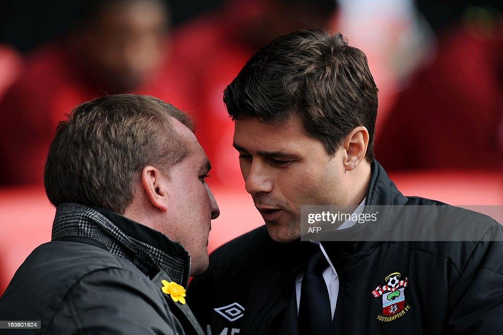 """Southampton's Argentinian manager Mauricio Pochettino (R) shakes hands with Liverppol manager Brendan Rodgers during the English Premier League football match between Southampton and Liverpool at St Mary's Stadium in Southampton on March 16, 2013. Southampton won 3-1. AFP PHOTO/ Olly GREENWOOD - RESTRICTED TO EDITORIAL USE. No use with unauthorized audio, video, data, fixture lists, club/league logos or """"live"""" services. Online in-match use limited to 45 images, no video emulation. No use in betting, games or single club/league/player publications."""