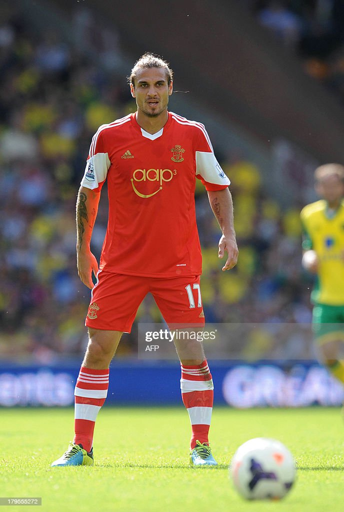 Southampton's Argentinian-Born Italian striker Dani Osvaldo prepares to take a free kick during the English Premier League football match between Norwich City and Southampton at Carrow Road in Norwich, eastern England on August 31, 2013. USE. No use with unauthorized audio, video, data, fixture lists, club/league logos or 'live' services. Online in-match use limited to 45 images, no video emulation. No use in betting, games or single club/league/player publications