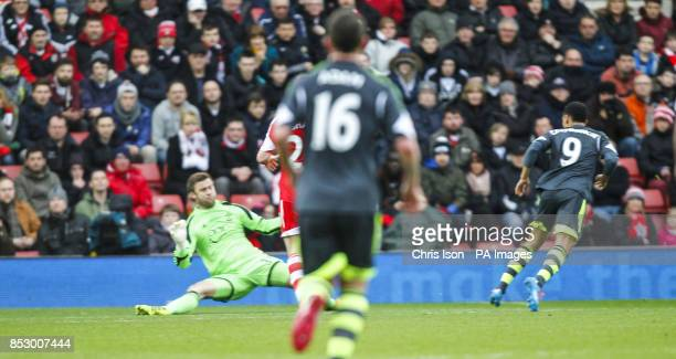Southampton's Artur Boruc is unable to stop the shot from Stoke City's Peter Odemwingie during the Barclays Premier League match at St Marys...
