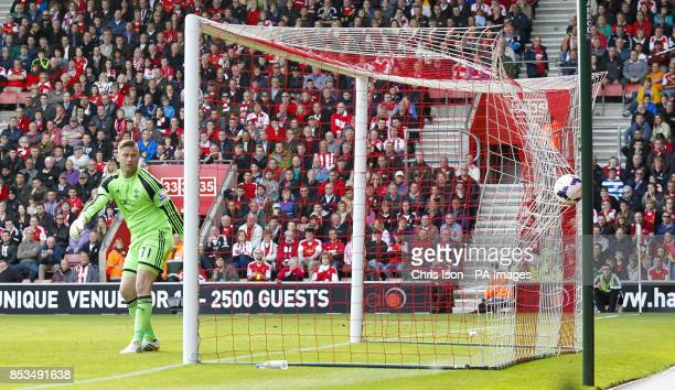 Southampton's Artur Boruc watches as Manchester United's Juan Mata free kick hits the net during the Barclays Premier League match at St Marys...
