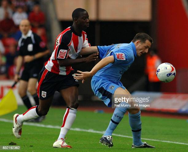 Southampton's Bradley WrightPhillips battles with Coventry City's David McNamee during the CocaCola Championship match at St Mary's Stadium