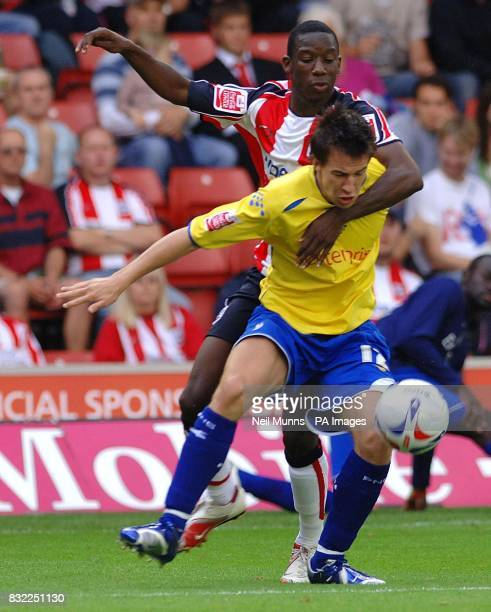 Southampton's Bradley WrightPhillips battles with Preston's Sean St Ledger during the CocaCola Championship match at St Mary's Stadium Southampton
