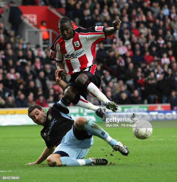 Southampton's Bradley WrightPhillips is tackled by Bury's Paul Scott during the FA Cup Fourth Round match at St Mary's Stadium Southampton
