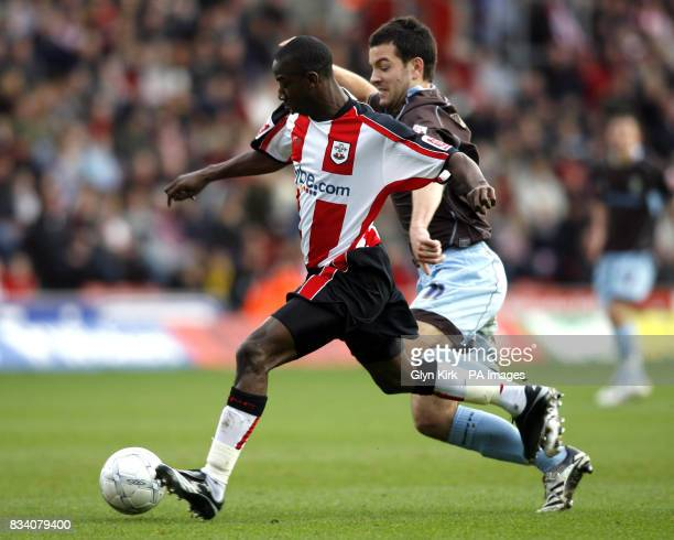 Southampton's Bradley WrightPhillips of goes past Bury's Brian BarryMurphy during the FA Cup Fourth Round match at St Mary's Stadium Southampton