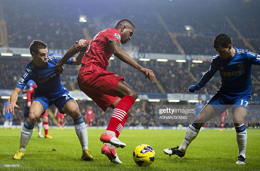 """Southampton's Brazilian striker Guly Do Prado (2nd L) vies with Chelsea's Spanish defender Cesar Azpilicueta (L) and Belgian midfielder Eden Hazard (R) during the English Premier League football match between Chelsea and Southampton at Stamford Bridge in London, on January 16, 2013. USE. No use with unauthorized audio, video, data, fixture lists, club/league logos or """"live"""" services. Online in-match use limited to 45 images, no video emulation. No use in betting, games or single club/league/player publications."""