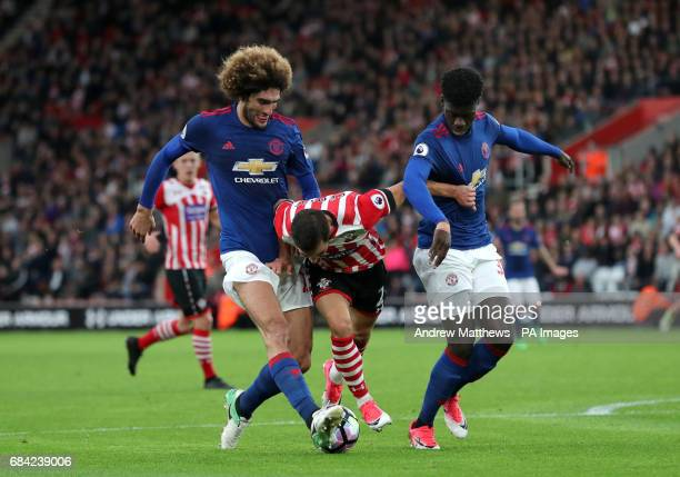 Southampton's Cedric Soares and Manchester United's Marouane Fellaini and Eric Bailly during the Premier League match at St Mary's Southampton