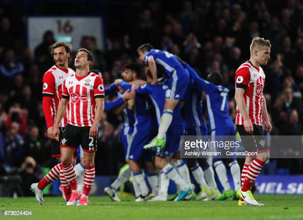Southampton's Cedric Soares Manolo Gabbiadini and Steven Davis dejected as Chelsea's Diego Costa celebrates scoring his sides third goal during the...