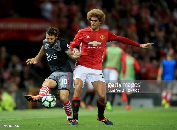 Southampton's Charlie Austin and Manchester United's Marouane Fellaini battle for the ball