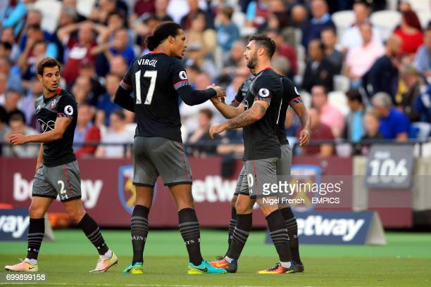 Southampton's Charlie Austin celebrates scoring his side's first goal of the game with Virgil van Dijk