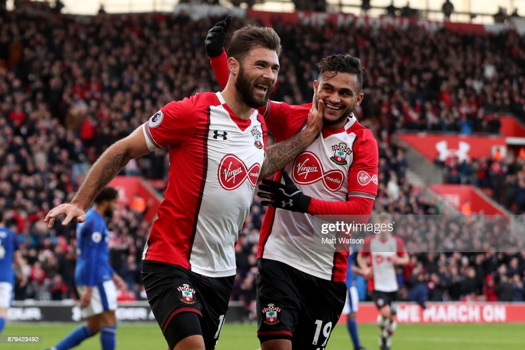 Southampton's Charlie Austin(L) celebrates with Sofiane boufal during the Premier League match between Southampton and Everton at St Mary's Stadium on November 26, 2017 in Southampton, England.