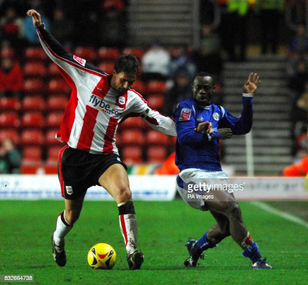 Southampton's Claus Lundekvam and Leicester's Elvis Hammond battle for the ball during the CocaCola Championship match at St Mary's Stadium...