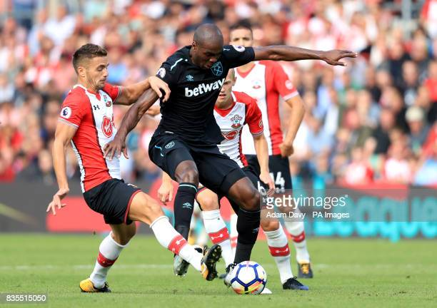 Southampton's Dusan Tadic and West Ham United's Angelo Ogbonna battle for the ball during the Premier League match at St Mary's Southampton