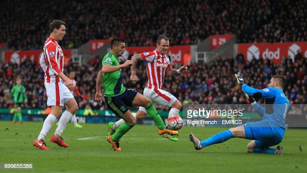Southampton's Dusan Tadic goes down in the box under a challenge from Stoke City goalkeeper Jack Butland but no foul is awarded