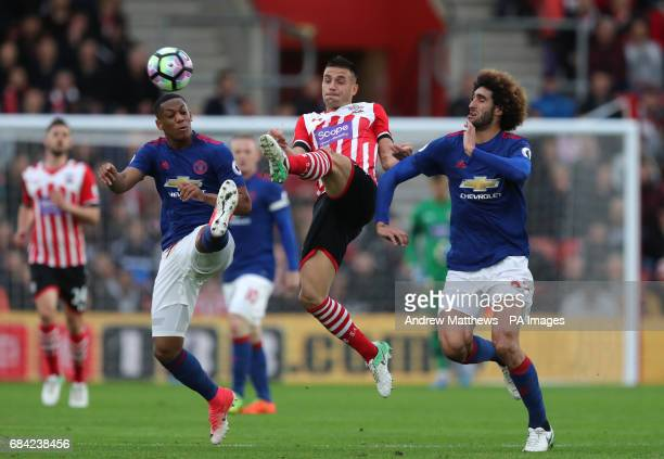 Southampton's Dusan Tadic in action against Manchester United's Marouane Fellaini and Anthony Martial during the Premier League match at St Mary's...