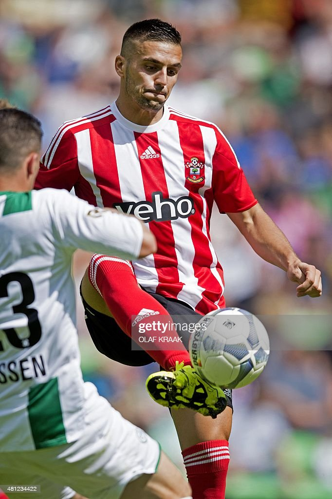 Southampton's Dusan Tadic vies for the ball with FC Groningen's Bryan Linssen during a friendly foootball match between Groningen and Southampton on...