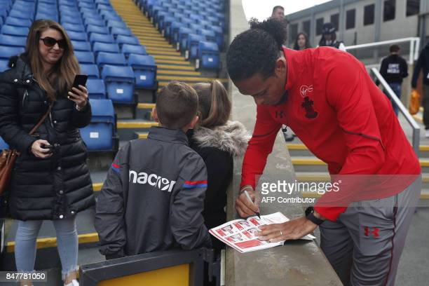 Southampton's Dutch defender Virgil van Dijk signs autographs for fans prior to the English Premier League football match between Crystal Palace and...