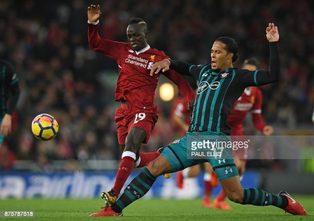 Southampton's Dutch defender Virgil van Dijk vies with Liverpool's Senegalese midfielder Sadio Mane during the English Premier League football match...
