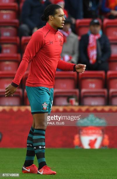 Southampton's Dutch defender Virgil van Dijk warms up ahead of the English Premier League football match between Liverpool and Southampton at Anfield...